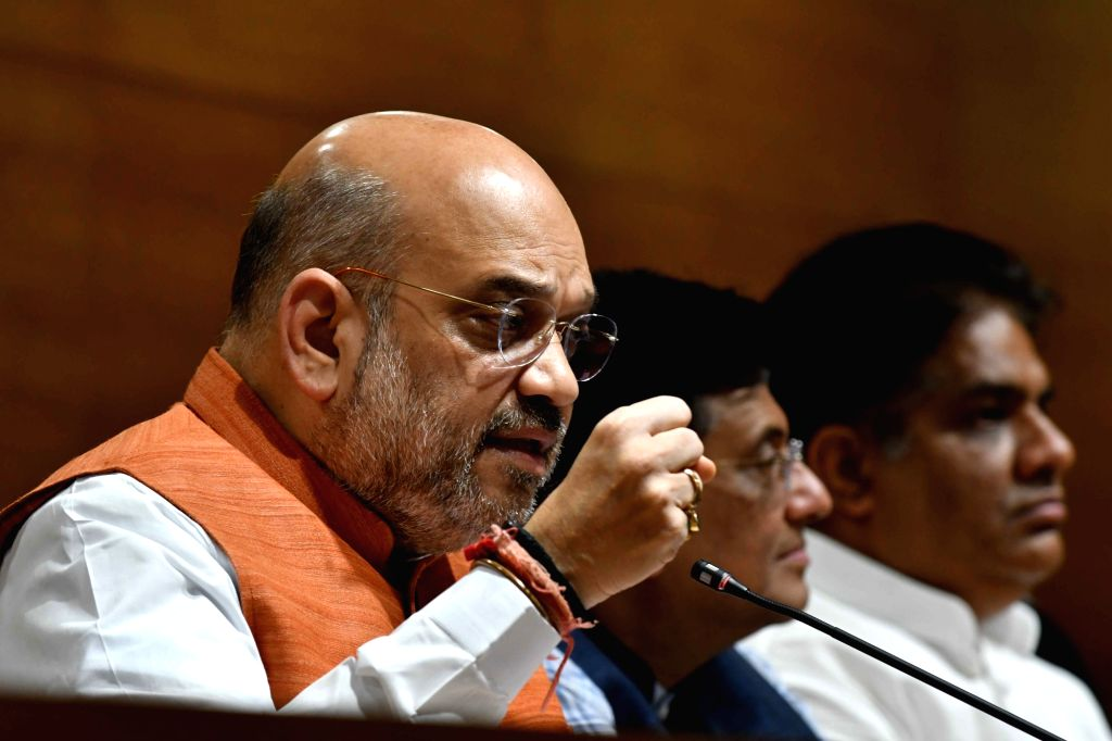 BJP chief Amit Shah addresses a press conference on the fourth anniversary of Narendra Modi-led BJP government, at the party headquarter in New Delhi on May 26, 2018. - Narendra Modi and Amit Shah