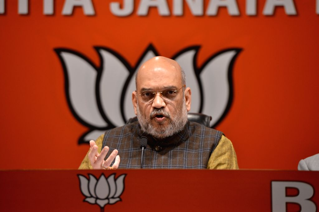 BJP chief Amit Shah addresses a press conference in New Delhi on Dec 14, 2018. - Amit Shah