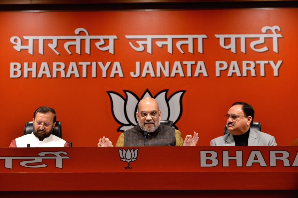 BJP chief Amit Shah addresses a press conference in New Delhi on Dec 14, 2018. Also seen Union Ministers and party leaders Prakash Javadekar and J.P. Nadda. - Amit Shah