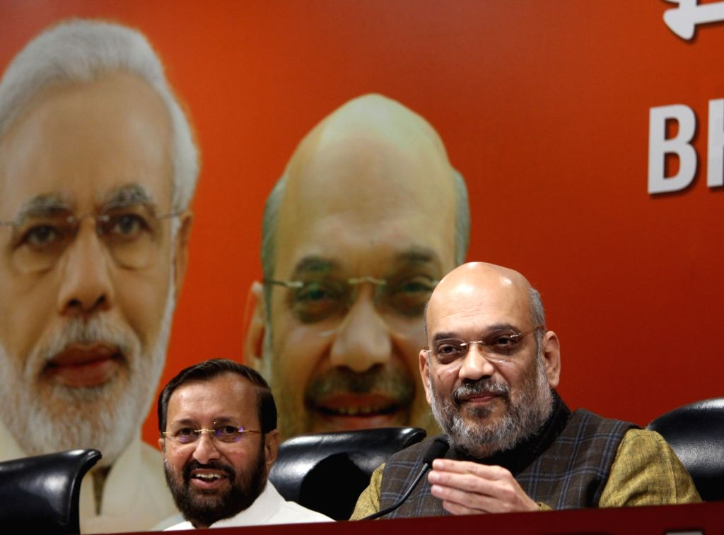 BJP chief Amit Shah addresses a press conference in New Delhi on Dec 14, 2018. Also seen Union Minister and party leader Prakash Javadekar. - Amit Shah