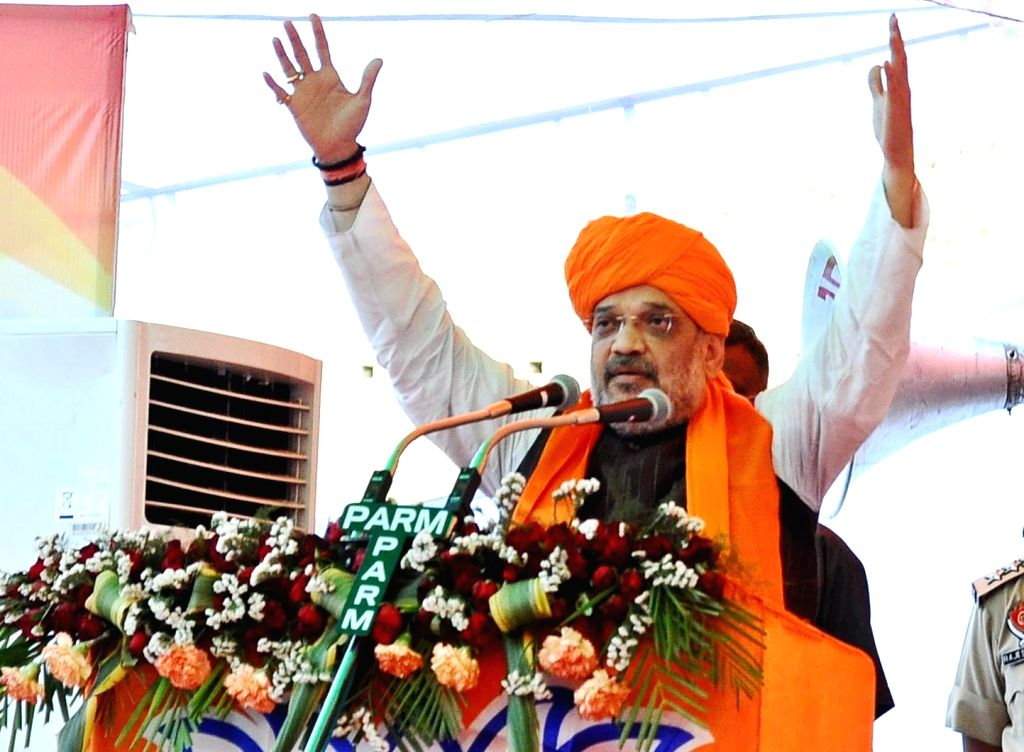 BJP chief Amit Shah addresses a public rally ahead of the 2019 Lok Sabha polls, in Punjab's Pathankot, on May 5, 2019. - Amit Shah