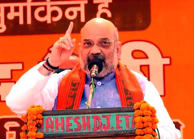 BJP chief Amit Shah addresses a public rally in Uttar Pradesh's Kasganj, on April 10, 2019. - Amit Shah