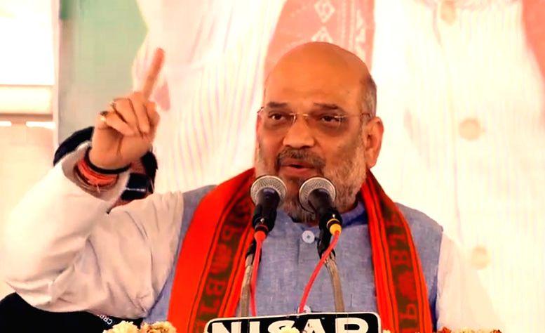 BJP chief Amit Shah addresses a public rally in Uttar Pradesh's Firozabad, on April 10, 2019. - Amit Shah