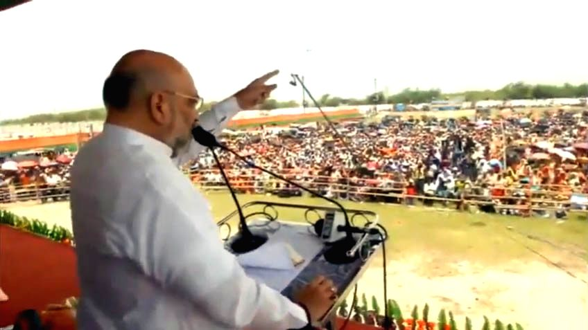 BJP chief Amit Shah addresses a public rally in Joynagar, West Bengal on May 13, 2019. - Amit Shah
