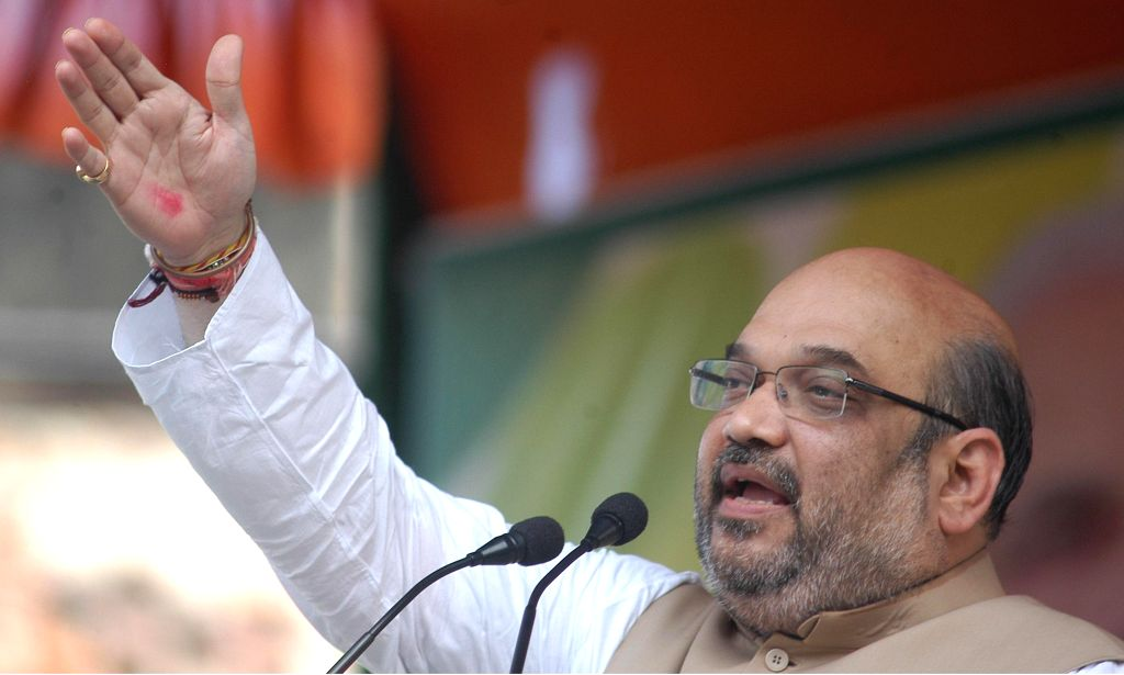 BJP chief Amit Shah addresses a rally in Kolkata on Sept 7, 2014.