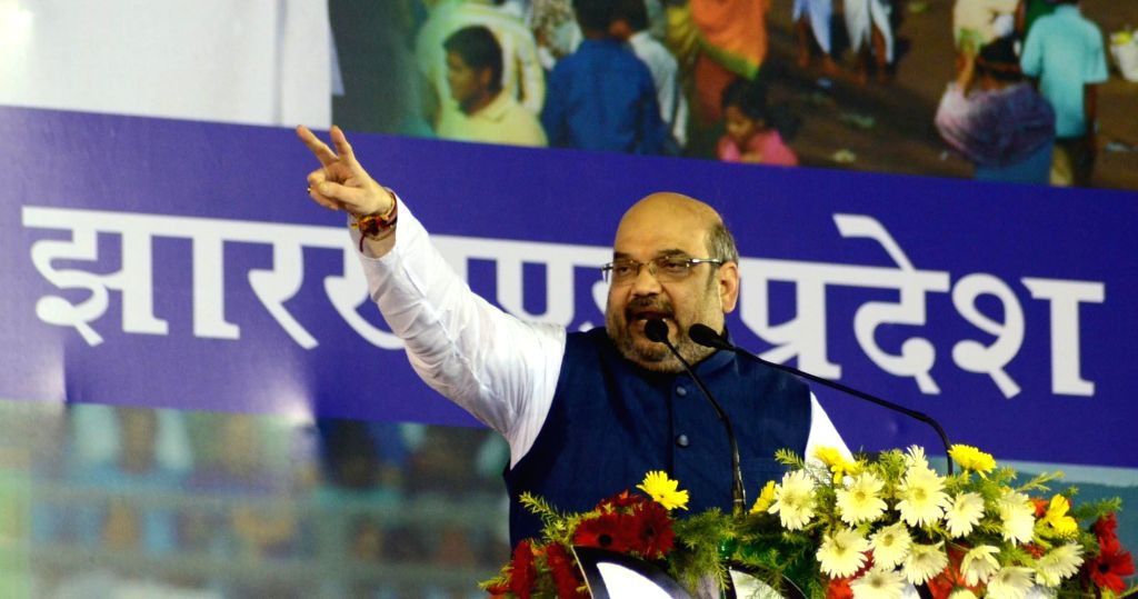 BJP chief Amit Shah addresses a rally in Ranchi on Sept 8, 2014. - Amit Shah