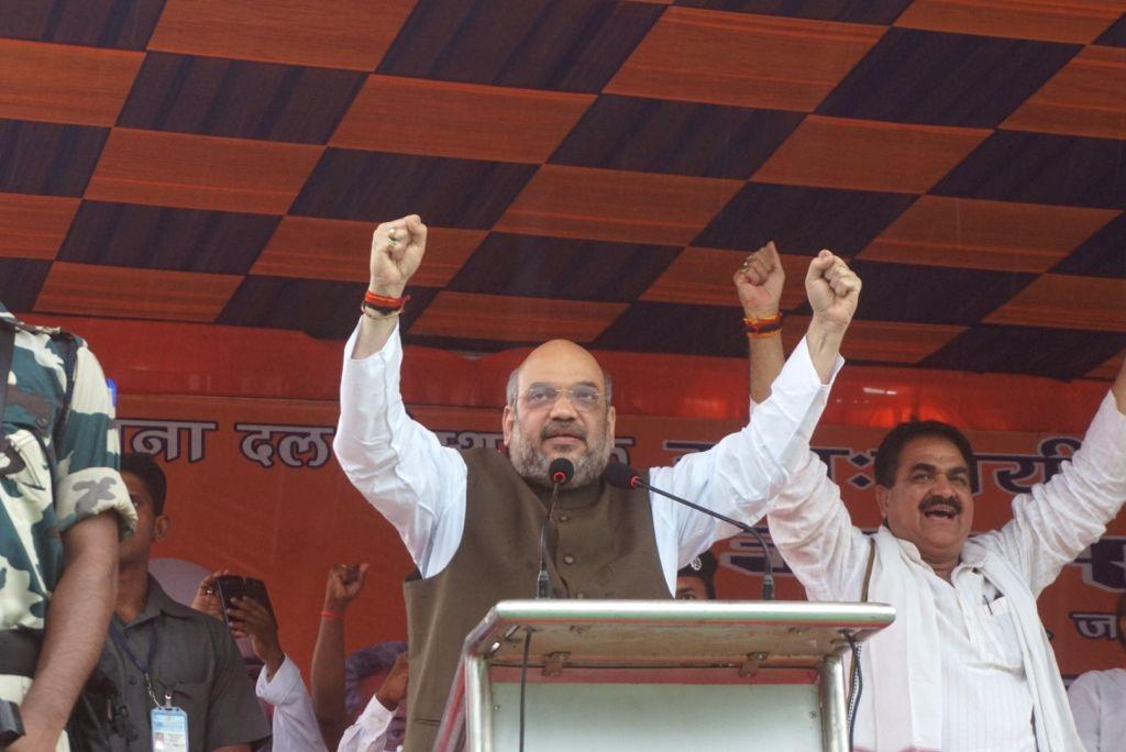 BJP chief Amit Shah addresses a rally in Varanasi on July 1, 2016. - Amit Shah