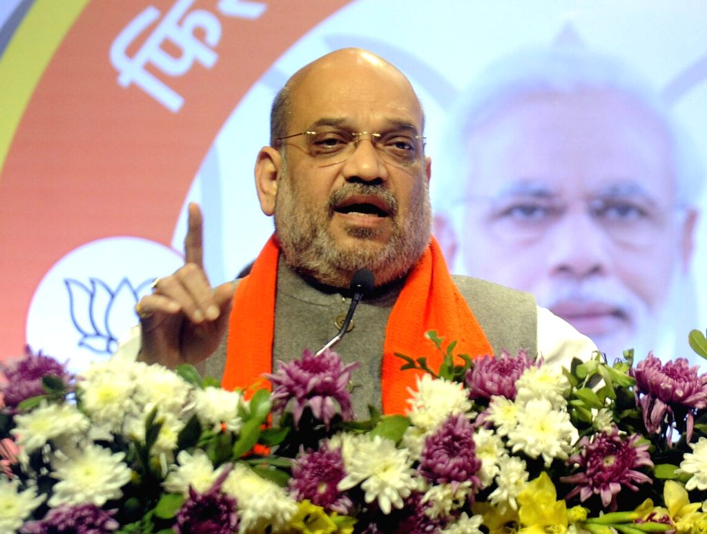 "BJP chief Amit Shah addresses at the launch of party's ""Mera Pariwar Bhajpa Pariwar"" campaign in Ahmedabad on Feb 12, 2019. - Amit Shah"