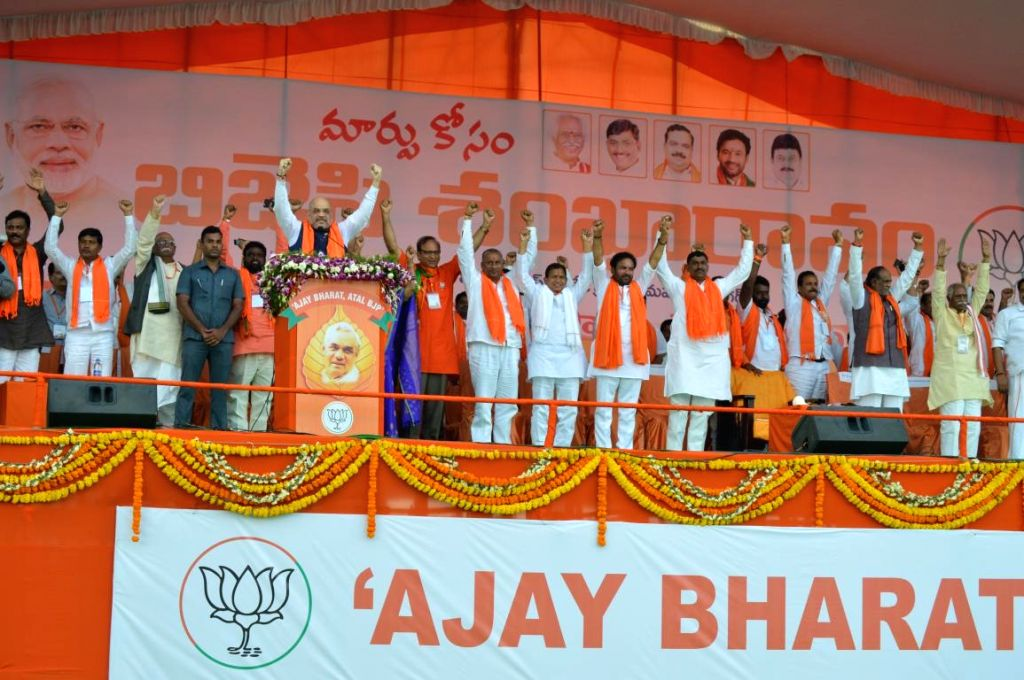 BJP chief Amit Shah addresses during a public meeting at Telangana's Mahabubnagar district on Sept 15, 2018. - Amit Shah