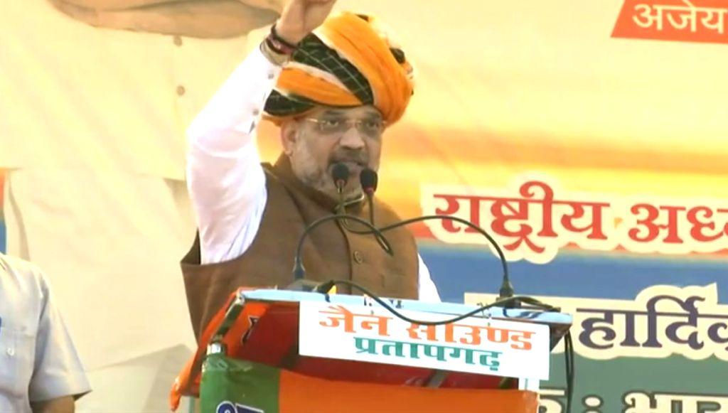 BJP chief Amit Shah addresses during a public meeting in Pratapgarh, Rajasthan, on Dec 3, 2018. - Amit Shah