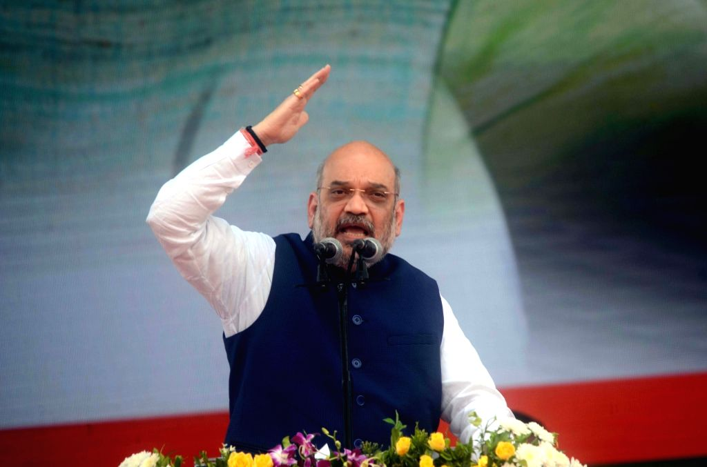 BJP chief Amit Shah addresses during a rally organised to celebrate BJP's 38th Foundation Day in Mumbai on April 6, 2018. - Amit Shah