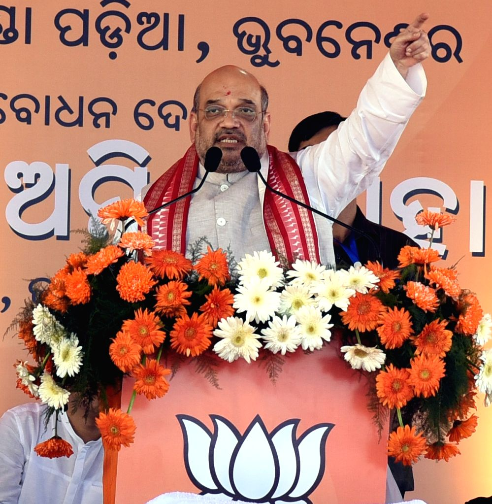 BJP chief Amit Shah addresses during a rally in Bhubaneswar on Nov 25, 2016. - Amit Shah