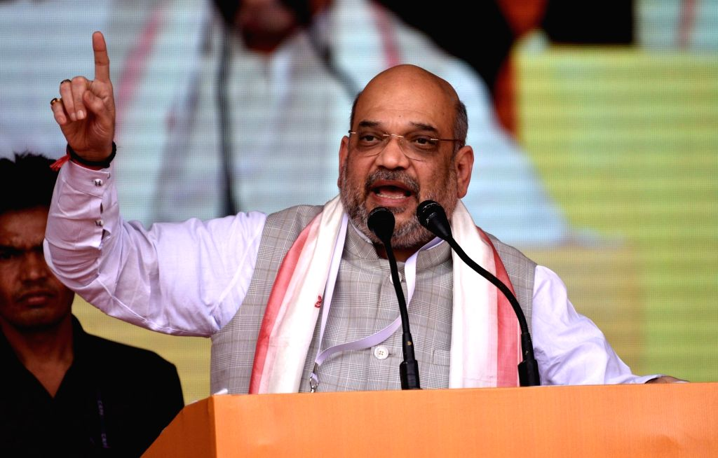 BJP chief Amit Shah addresses during Booth President Sammelan in Guwahati on March 24, 2018. - Amit Shah