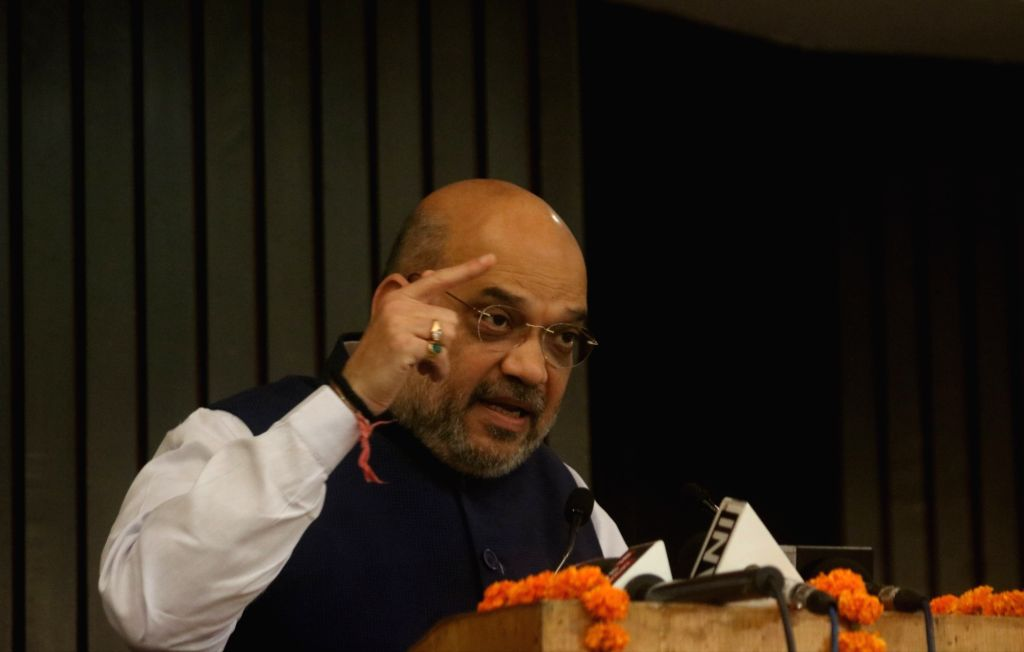 "BJP chief Amit Shah addresses during National Conference on ""Reforming Agrarian Economy: Role of Insurance"", in New Delhi on July 21, 2018. - Amit Shah"