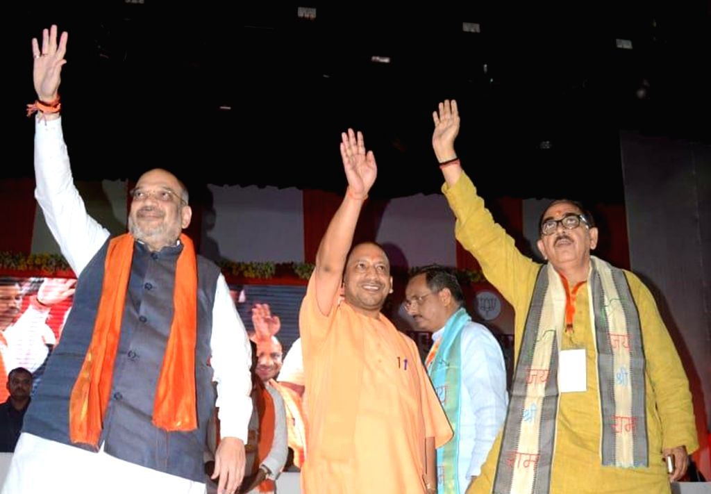 BJP chief Amit Shah along with party leader and Uttar Pradesh Chief Minister Yogi Adityanath and state BJP chief Mahendra Nath Pandey during a party meeting, in Agra on July 5, 2018. - Yogi Adityanath, Amit Shah and Mahendra Nath Pandey