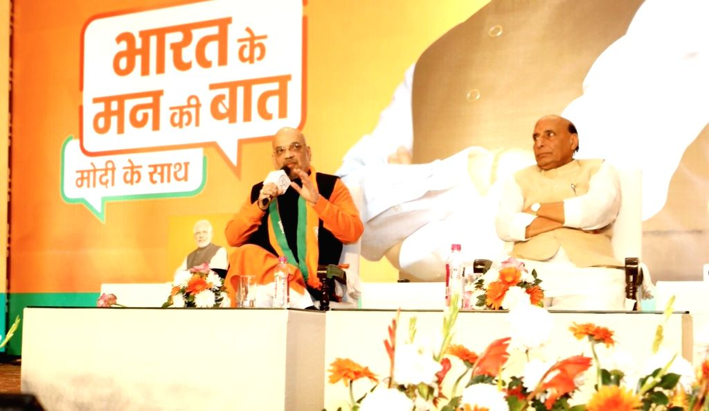 BJP chief Amit Shah along with Union Minister and BJP leader Rajnath Singh, addresses at the launch of 'Bharat ke mann ki baat, Modi ke saath' campaign in New Delhi, on Feb 3, 2019. - Amit Shah and Rajnath Singh