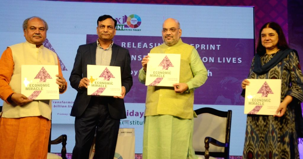 """BJP chief Amit Shah along with Union Ministers Narendra Singh Tomar, Maneka Gandhi and author Pradeep Gupta during the launch of a book """"Blueprint of an Economic Miracle authored by ... - Narendra Singh Tomar, Maneka Gandhi, Amit Shah and Pradeep Gupta"""