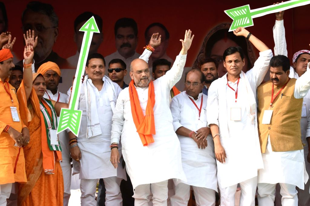 BJP chief Amit Shah and Bihar party President Nityanand Rai wave at supporters during a public rally in Bihar's Siwan, on May 6, 2019. - Amit Shah and Nityanand Rai