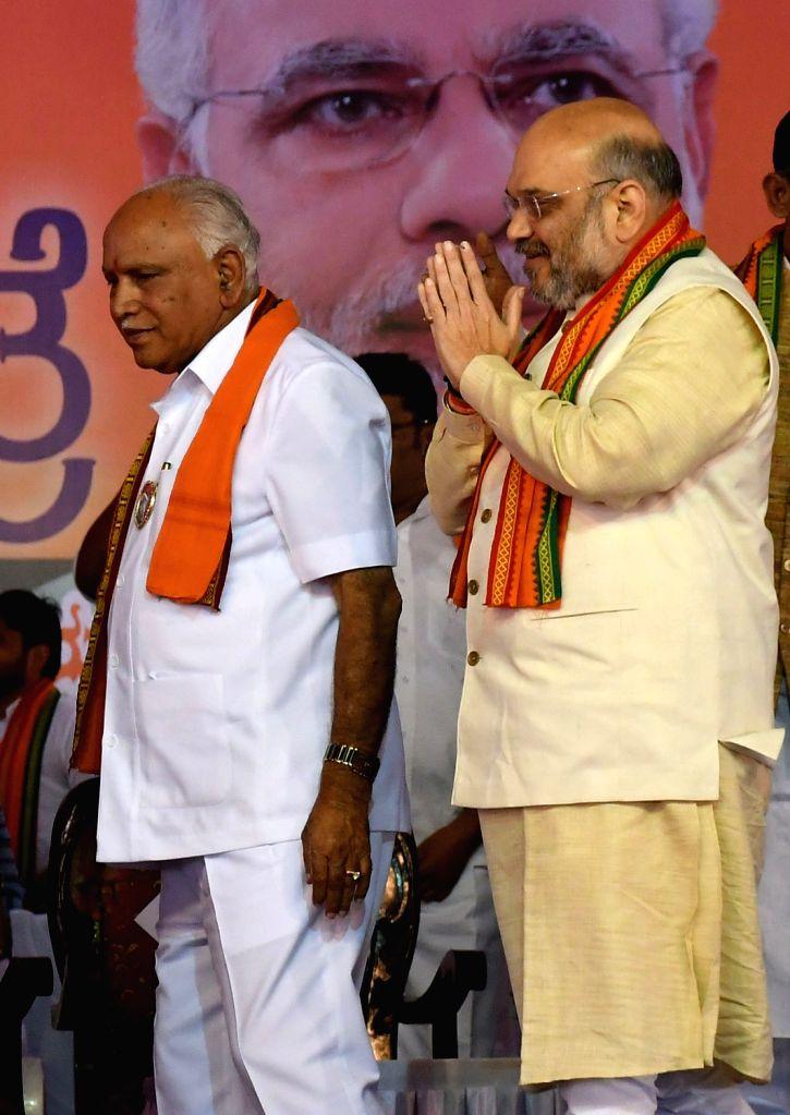 BJP chief Amit Shah and Karnataka BJP chief BS Yeddyurappa during a party programme in Mysuru, on Jan 25, 2018. - Amit Shah