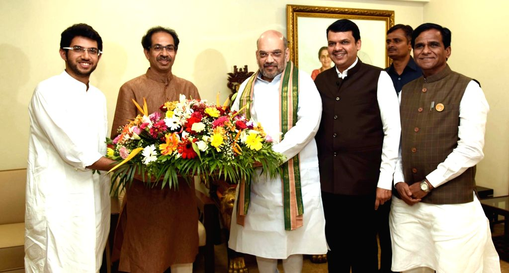 BJP chief Amit Shah and Maharashtra Chief Minister Devendra Fadnavis being welcomed by Shiv Sena Chief Uddhav Thackeray and his son Aditya Thackeray at Matoshree in Mumbai on June 18, 2017. ... - Devendra Fadnavis and Amit Shah