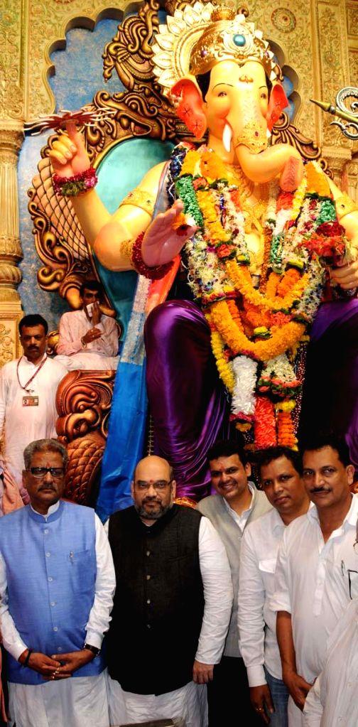 BJP chief Amit Shah and Mumbai BJP chief Ashish Shelar visit to Lalbaug Cha Raja Utsav Mandal at Lalbaug in Mumbai on Sept 4, 2014.