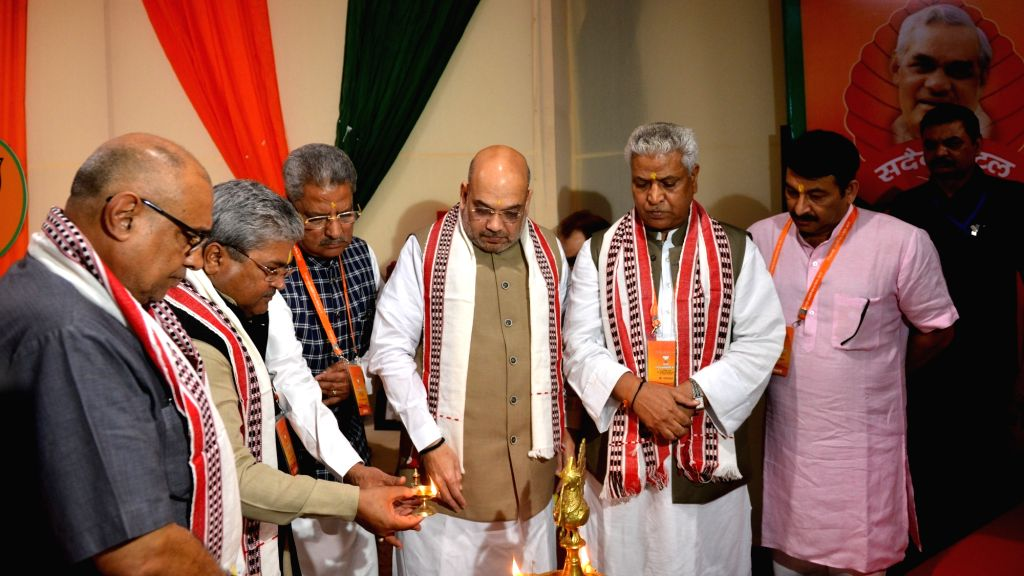 BJP chief Amit Shah and the party's Delhi chief Manoj Tiwari light the inaugural lamp along with other party leaders at BJP's National Executive meeting, in New Delhi on Sept 8, 2018. - Amit Shah