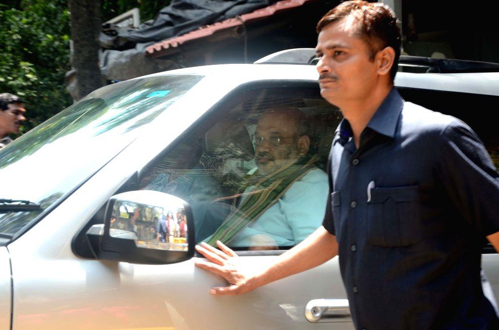 BJP chief Amit Shah arrives at Matoshree to meet Shiv Sena Chief Uddhav Thackeray in Mumbai on June 18, 2017. Also seen Maharashtra BJP chief Raosaheb Danve. - Amit Shah