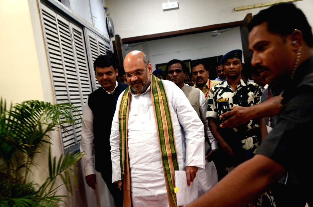 BJP chief Amit Shah arrives to attend a press conference in Mumbai on June 17, 2017. Also seen Maharashtra Chief Minister Devendra Fadnavis. - Devendra Fadnavis and Amit Shah