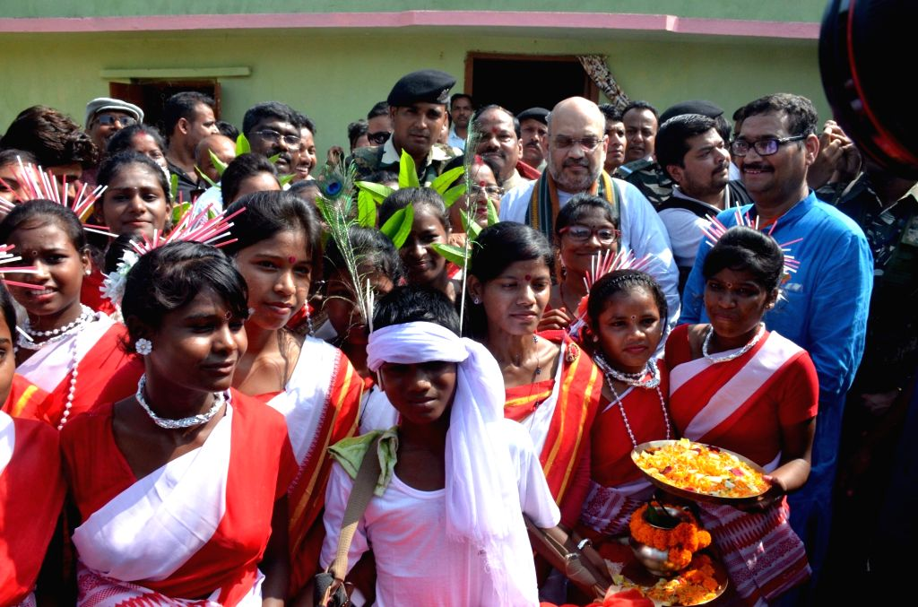 BJP chief Amit Shah at a tribal party worker's residence in Ranchi on Sept 16, 2017. - Amit Shah