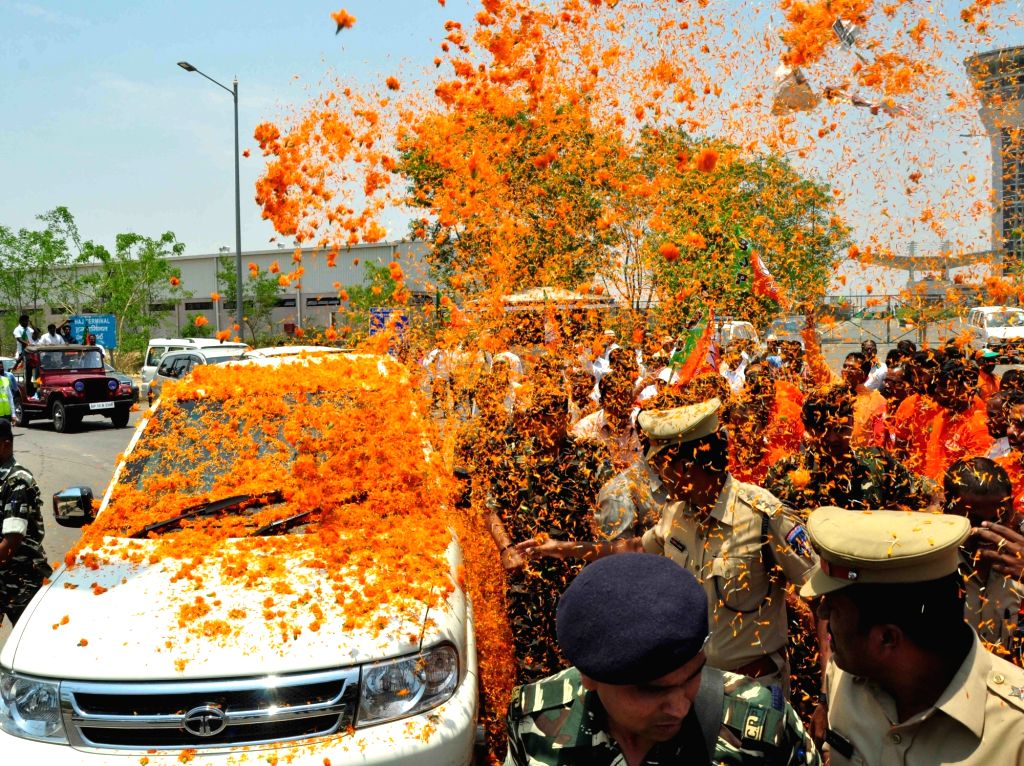 BJP chief Amit Shah being greeted on his arrival at Rajiv Gandhi International airport in Hyderabad on May 22, 2017. - Amit Shah and Rajiv Gandhi International