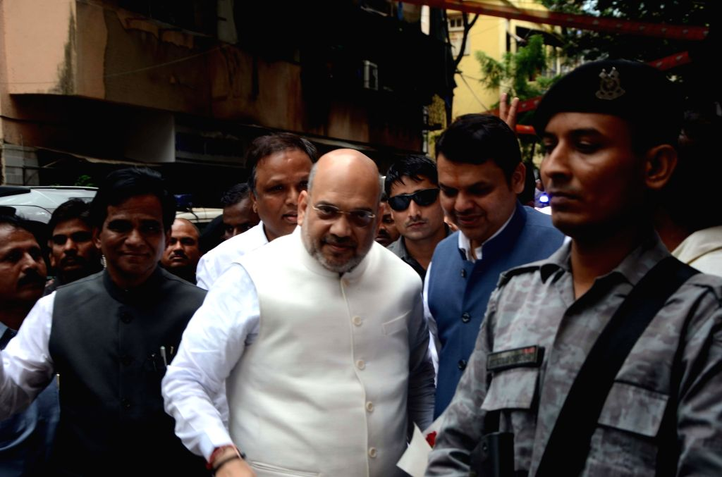 BJP chief Amit Shah being received by Maharashtra Chief Minister Devendra Fadnavis and Maharashtra BJP chief Raosaheb Danve as he arrives to attend a party meeting in Mumbai on July 22, 2018. - Devendra Fadnavis and Amit Shah