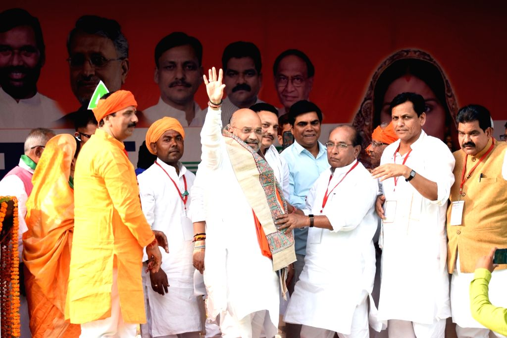 BJP chief Amit Shah being welcomed by party workers on his arrival to address a public rally in Bihar's Siwan, on May 6, 2019. - Amit Shah