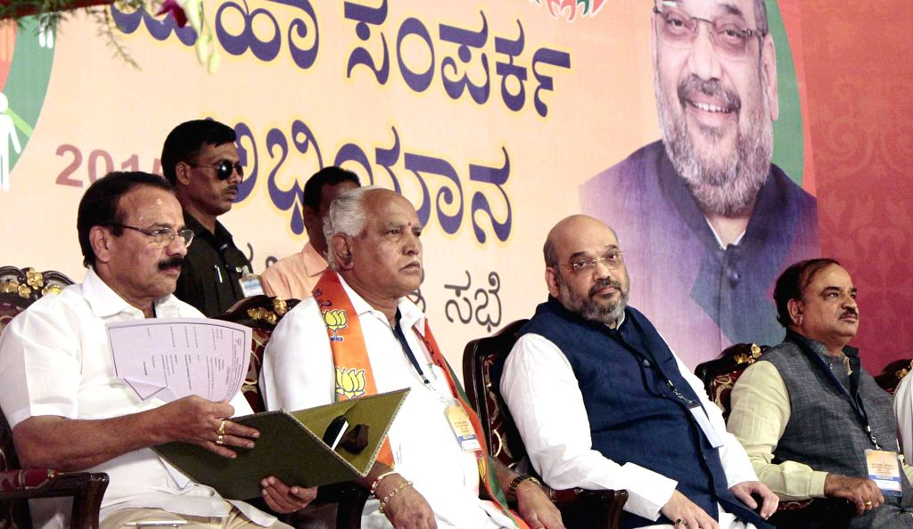 BJP chief Amit Shah during a BJP South Zone district presidents and office bearers meet in Bengaluru on July 5, 2015. Also seen Union Minister of Law and Justice DV Sadananda Gowda, BJP ... - Anant Kumar and Amit Shah
