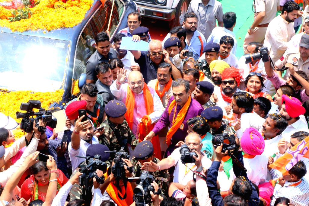 BJP chief Amit Shah during a road show in Chandigarh on May 20, 2017. Shah on a two-day visit as part of his country-wide 95-day tour. - Amit Shah