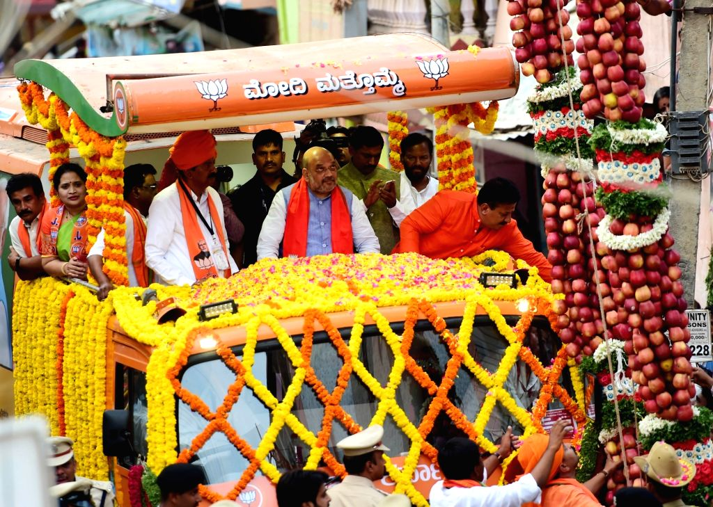 BJP chief Amit Shah during a road show in Bengaluru on April 10, 2019. - Amit Shah