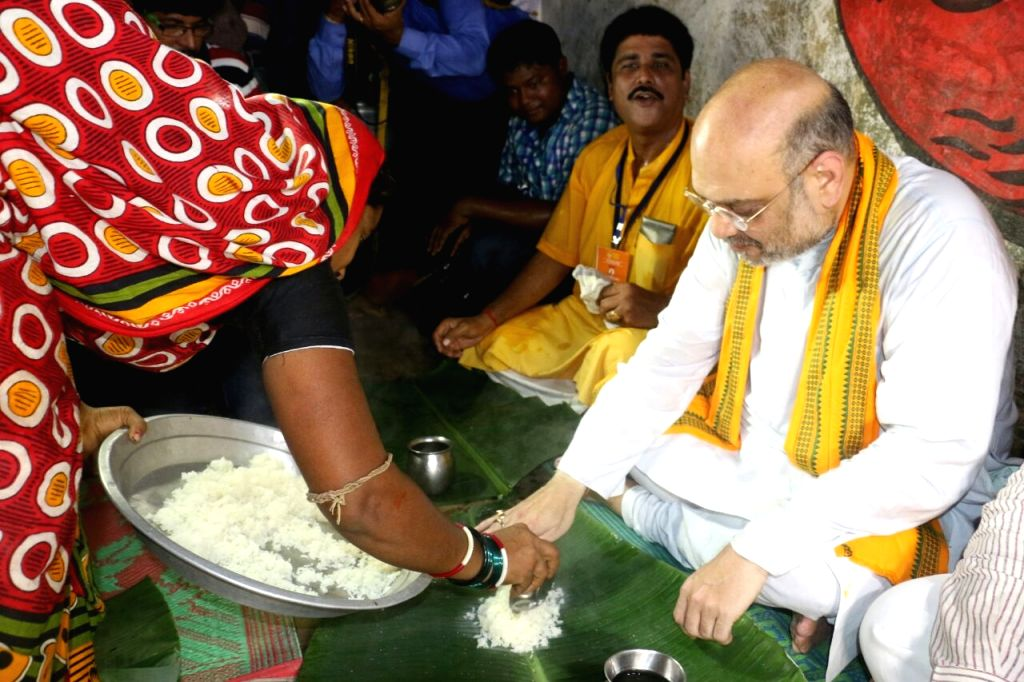 BJP chief Amit Shah during lunch in Berhampur of Odisha's Ganjam district on July 4, 2017. - Amit Shah