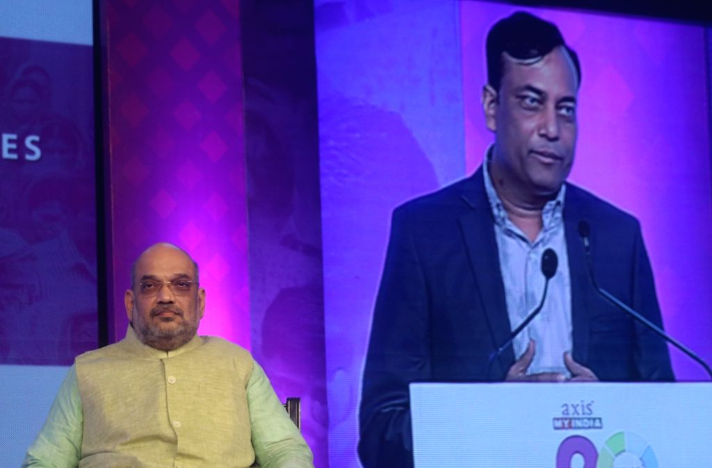 """BJP chief Amit Shah during the launch of a book """"Blueprint of an Economic Miracle"""" authored by Pradeep Gupta in New Delhi on Aug 10, 2018. - Amit Shah and Pradeep Gupta"""