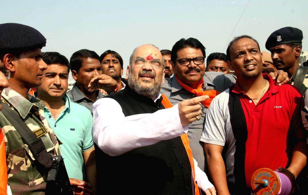 BJP chief Amit Shah flies a kite ahead of Makar Sankranti in Ahmedabad, on Jan 14, 2016.