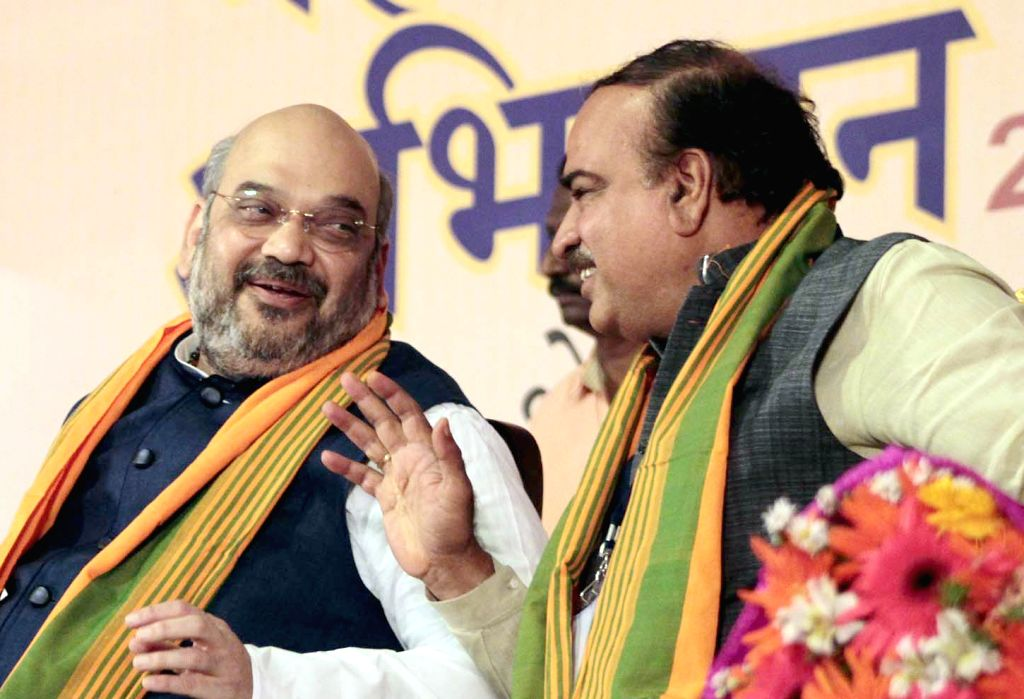 BJP chief Amit Shah interacts with Union Chemical and Fertilizers Minister Anant Kumar during a BJP South Zone district presidents and office bearers meet in Bengaluru on July 5, 2015. - Anant Kumar and Amit Shah