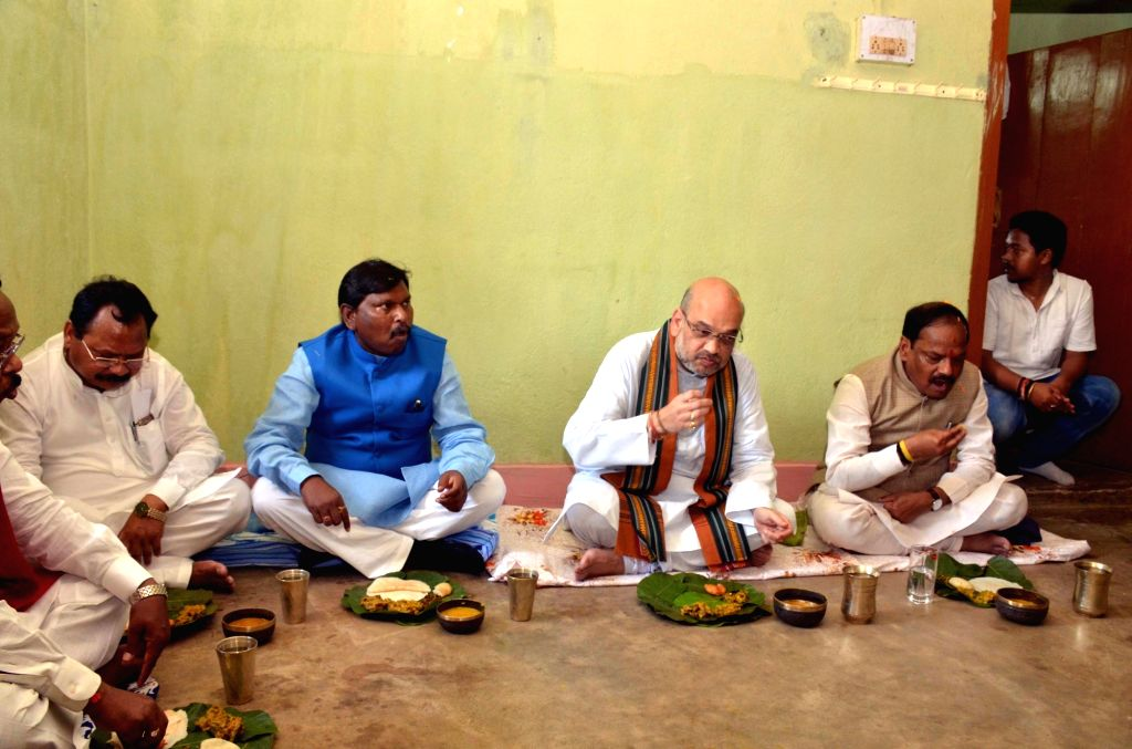 BJP chief Amit Shah, Jharkhand Chief Minister Raghubar Das and former Jharkhand Chief Minister Arjun Munda have lunch at a tribal party worker's residence in Ranchi on Sept 16, 2017. - Raghubar Das, Amit Shah and Arjun Munda