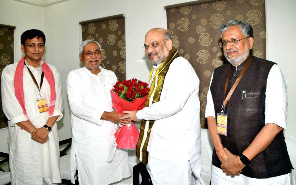 BJP chief Amit Shah meets Bihar Chief Minister and JD-U chief Nitish Kumar, in Patna on July 12, 2018. Also seen Bihar Deputy Chief Minister and BJP leader Sushil Kumar Modi and BJP state ... - Amit Shah, Nitish Kumar, Sushil Kumar Modi and Nityanand Rai