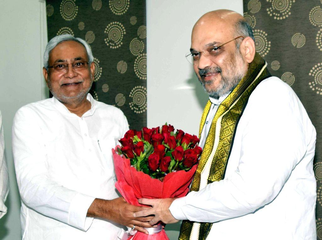 BJP chief Amit Shah meets Bihar Chief Minister and JD-U chief  Nitish Kumar, in Patna on July 12, 2018. - Amit Shah and Nitish Kumar