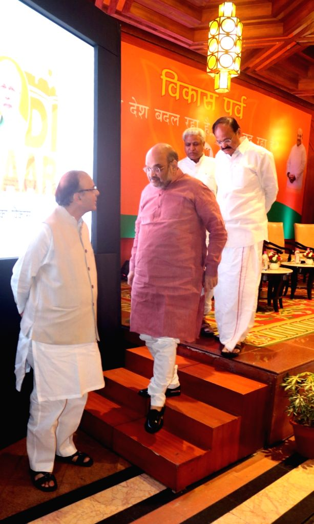 BJP chief Amit Shah, national general secretary Ram Lal with Union Ministers Arun Jaitley and M Venkaiah Naidu during a programme organised to interact with journalists regading the ... - Ministers Arun Jaitley, M Venkaiah Naidu and Amit Shah