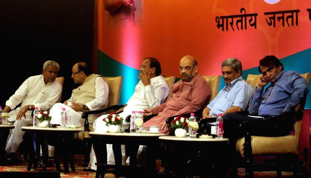BJP chief Amit Shah, national general secretary Ram Lal with Union Ministers Arun Jaitley, Manohar Parrikar, Suresh Prabhu and M Venkaiah Naidu during a programme organised to interact ... - Ministers Arun Jaitley, Manohar Parrikar, Suresh Prabhu, M Venkaiah Naidu and Amit Shah