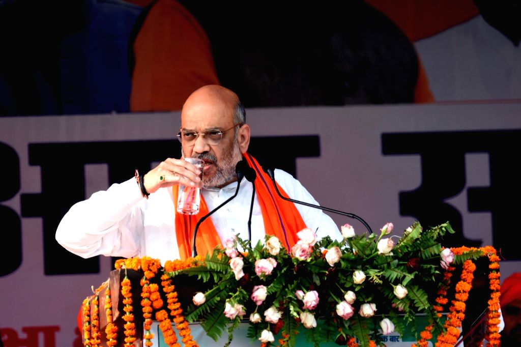 BJP chief Amit Shah pauses to have water in the midst of his speech during a public rally in Bihar's Siwan, on May 6, 2019. - Amit Shah