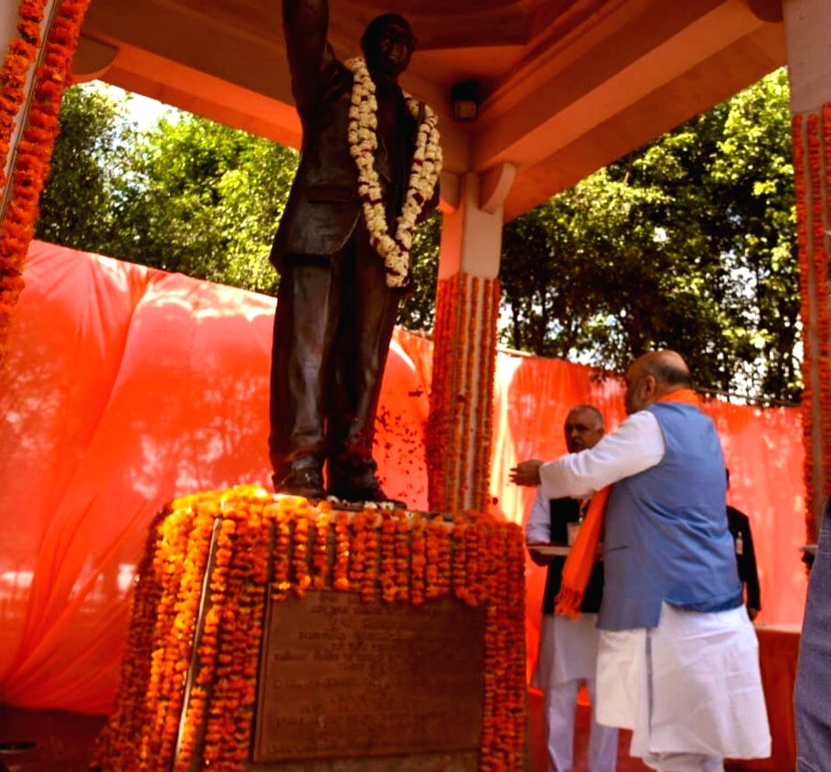 BJP chief Amit Shah pays floral tributes at the statue of B.R. Ambedkar in Lucknow on Feb 23, 2019. - Amit Shah