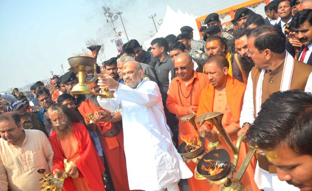 BJP chief Amit Shah performs aarti at Sangam - the trinity of rivers Ganga, Yamuna and the mythical Saraswati -  during Kumbh Mela 2019, in Prayagraj, on Feb 13, 2019. Also seen Uttar ... - Yogi Adityanath and Amit Shah