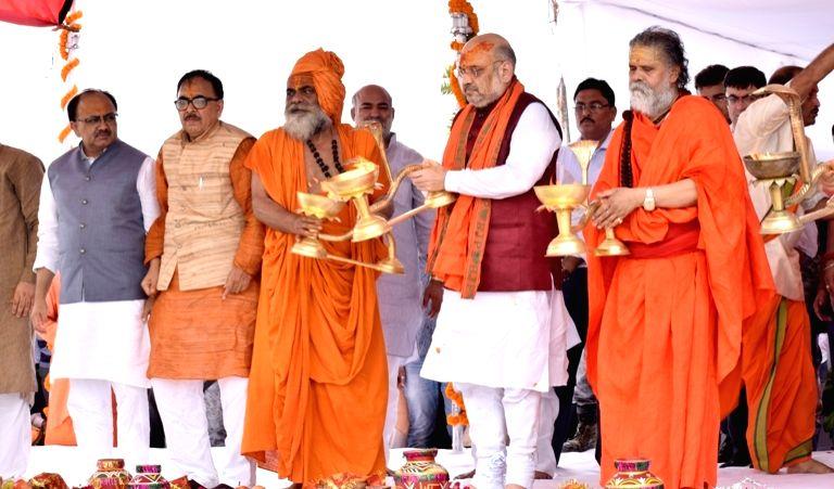 BJP chief Amit Shah performs ritual at sangam, in Allahabad, on July 27, 2018. - Amit Shah
