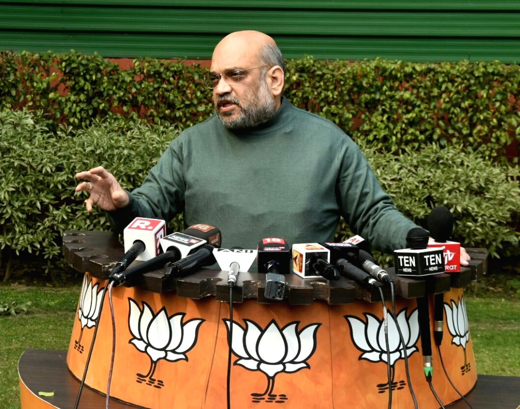 BJP Chief Amit Shah talks to media persons after the presentation of interim budget 2019 in Parliament, in New Delhi on Feb 1, 2019. - Amit Shah