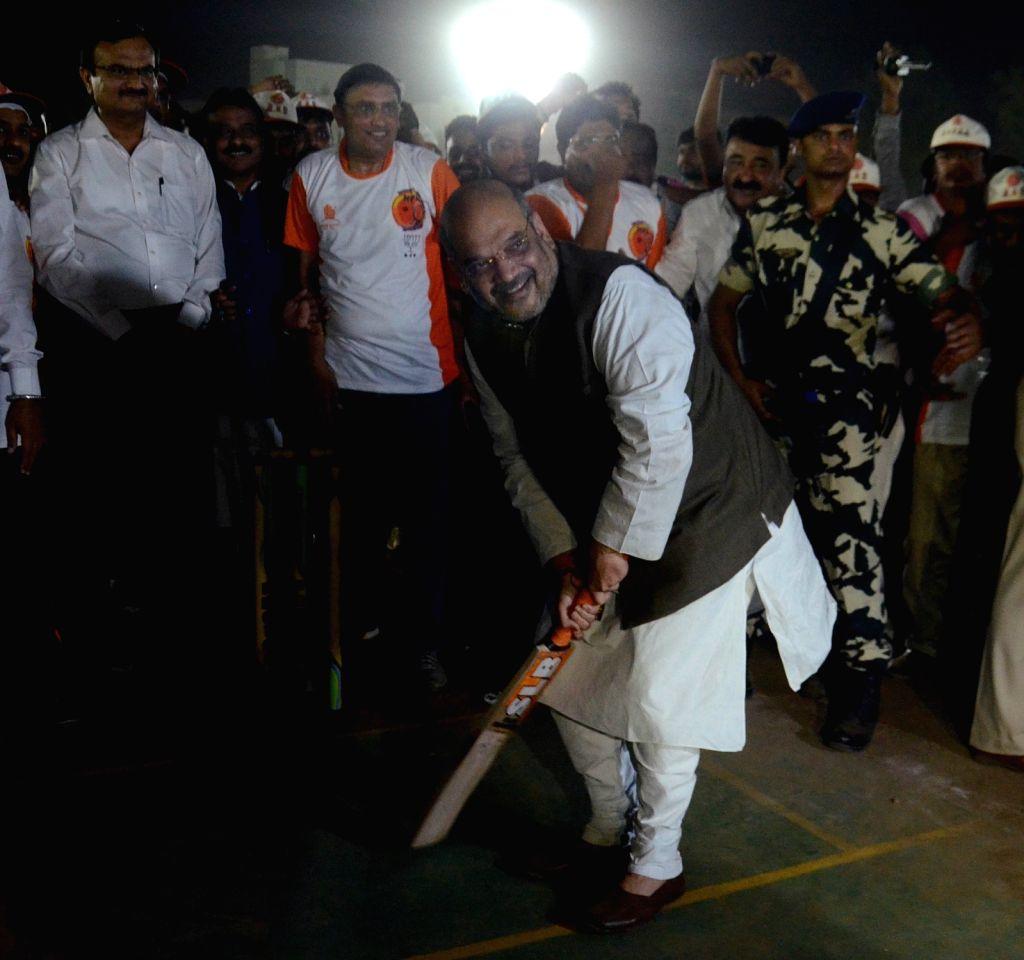 BJP chief Amit Shah tries his hands at batting at the inauguration of Karnavati Premier League  (KPL) 2016 in Ahmedabad, on May 15, 2016. - Amit Shah